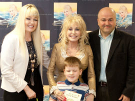 Dolly Parton Presents Book To Dylan Manifold (Image Courtesy Optometry Today)